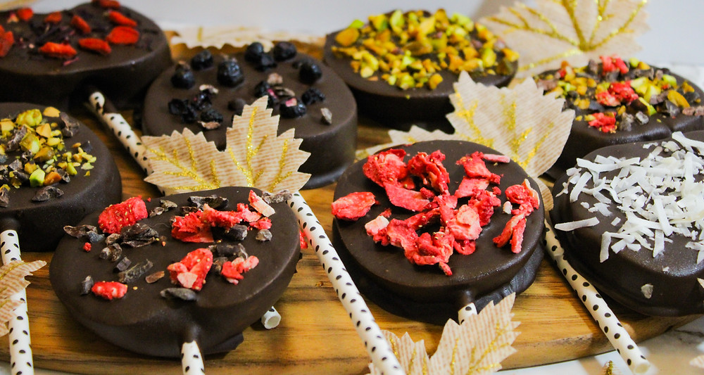 dark chocolate covered apple slices with toppings