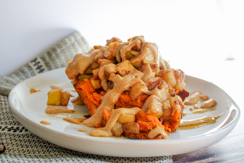 sweet potato stuffed with cooked apples, cinnamon, maple syrup, ginger, topped with peanut butter