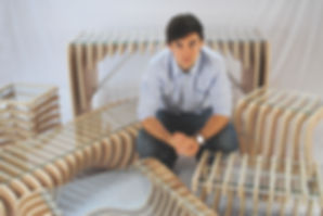 OpenForm Furniture's founder, Sebastian White, with our luxury pieces.
