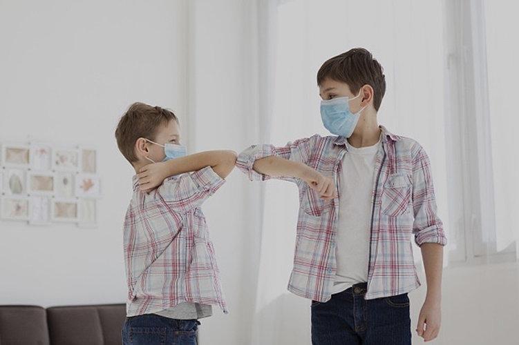 kids-touching-elbows-while-inside-wearin
