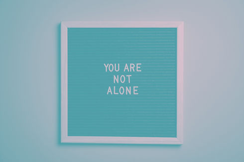 you-are-not-alone-quote-board-on-brown-wooden-frame-2821220_edited.jpg