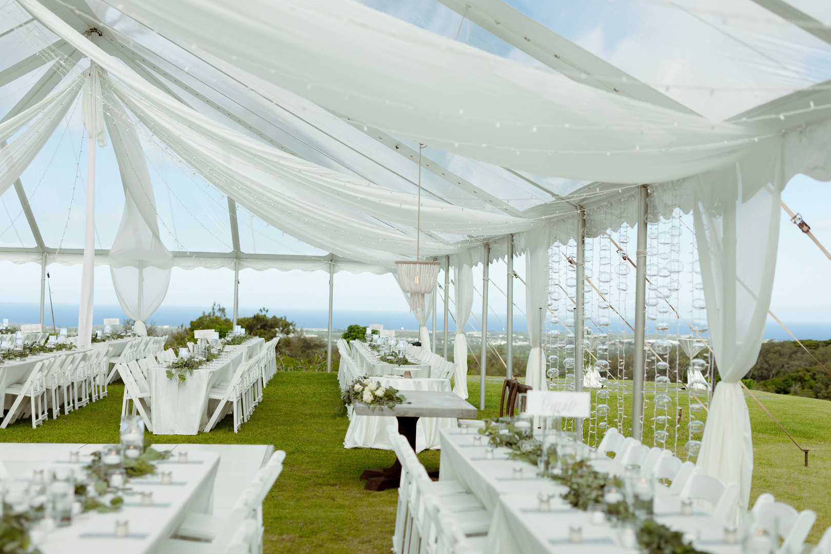 Clear Top Tent Wedding with Twinkle Lights and Partial Fabric Draping