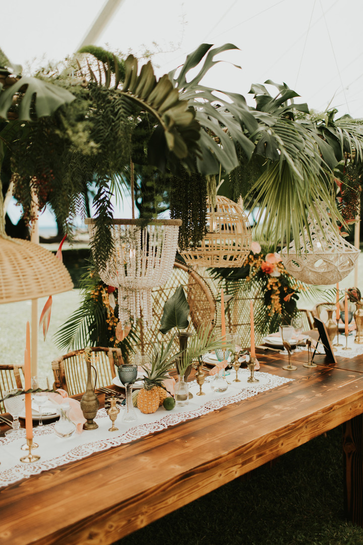 Tropical greenery trussing with a mix of wicker and macrame pendants
