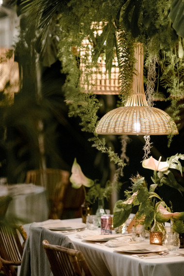 Wicker Pendants with Greenery covering trussing