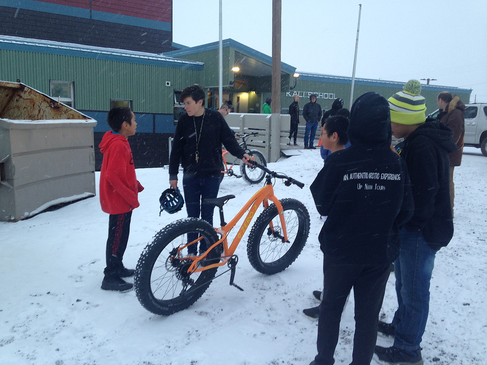 Lael helping students get ready to ride Kali School's new 9:ZERO:7 Whiteout