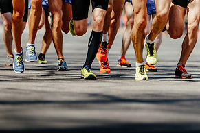 Canva - View of a Group of Runner's Legs