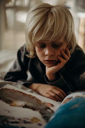selective-focus-photography-of-boy-resti
