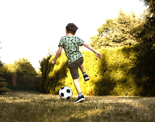 low-angle-photo-of-a-boy-playing-soccer-