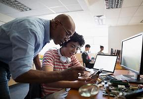 Teacher Assisting a Student