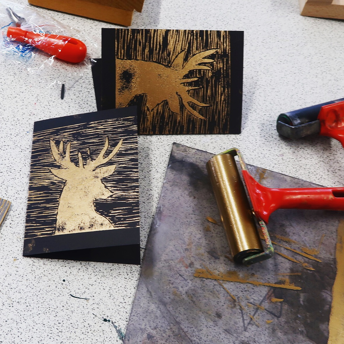 Christmas card lino prints in gold