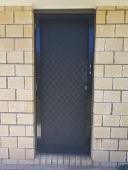 Diamond grille security door, Warner