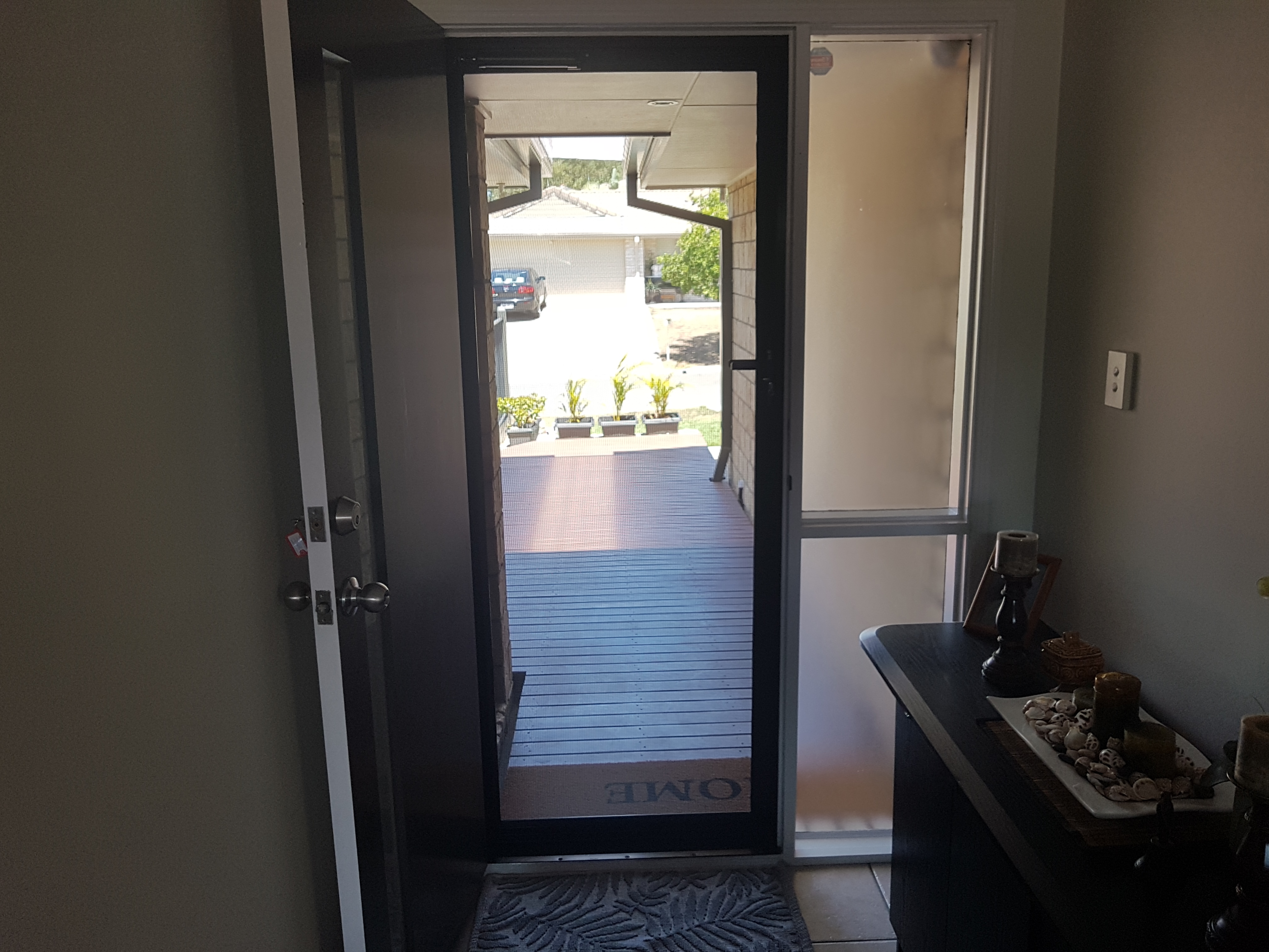 Security doors with stainless steel mesh allow uninterrupted views out