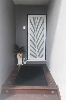 Decoview perforated aluminium mesh security door Springbrook white