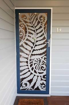 Decoview lasercut aluminium security door silver fern