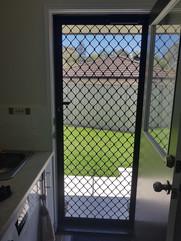 Diamond grille security screen door Warner