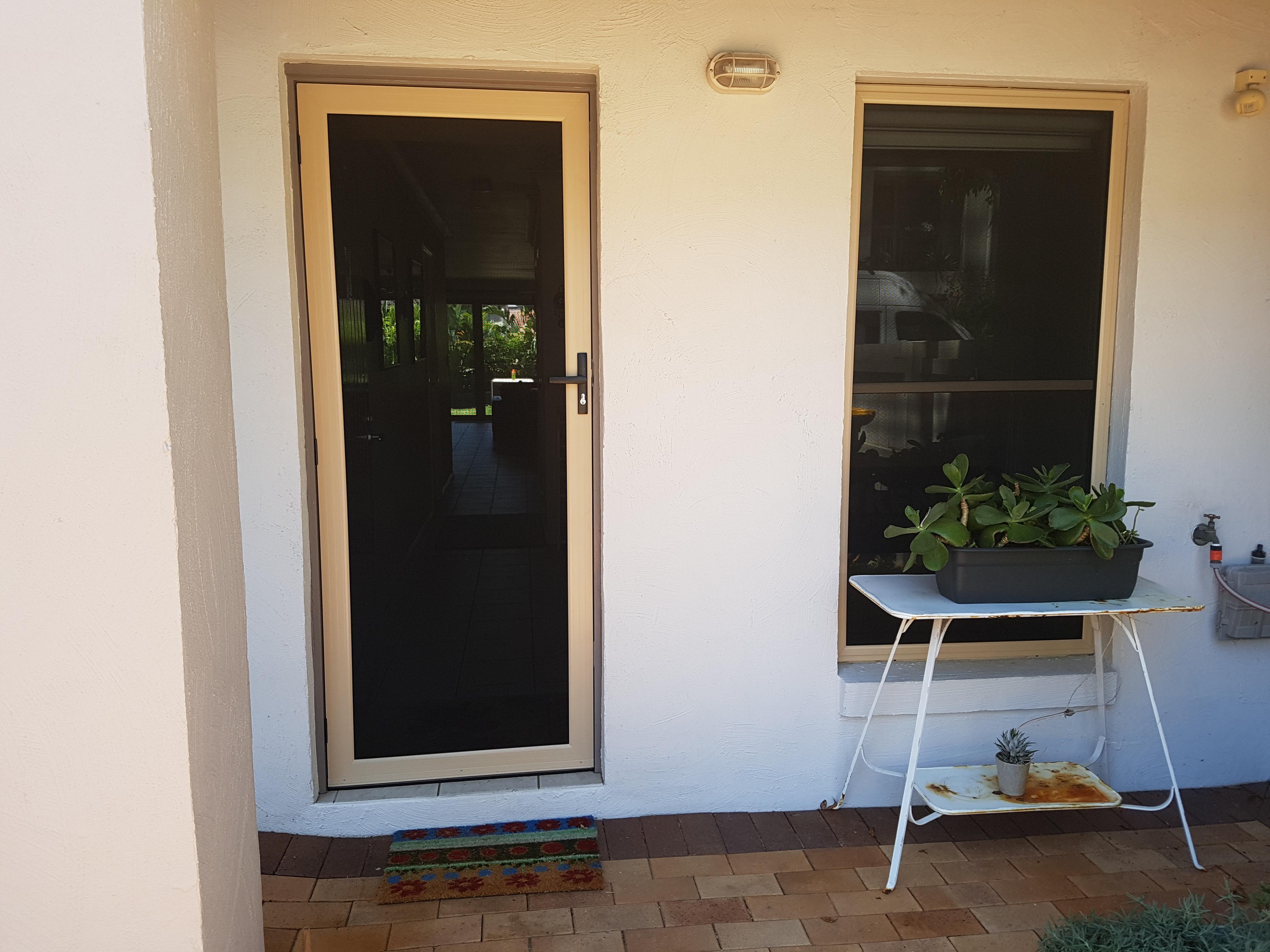 Security door and window in stone beige, Bulimba