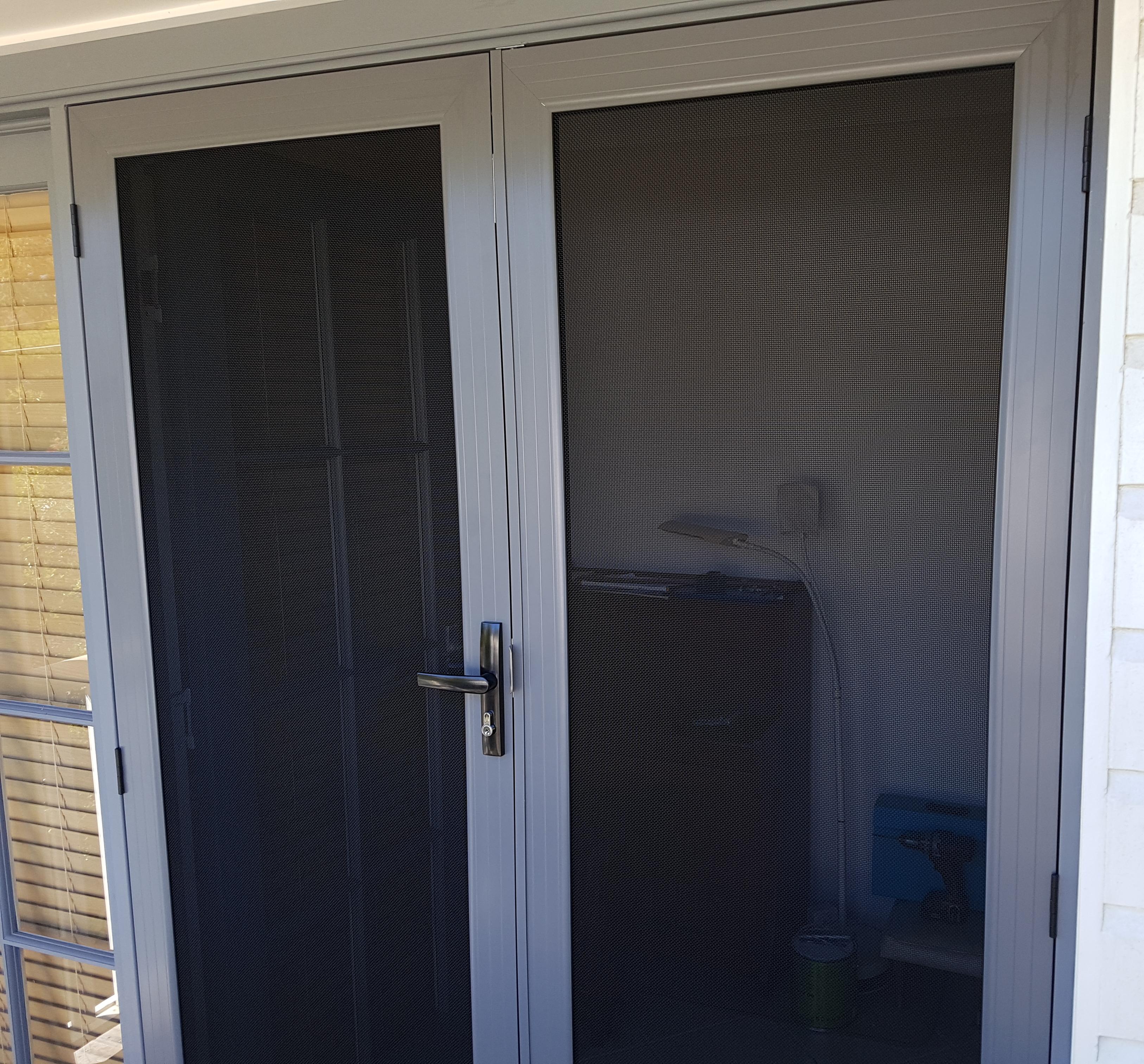Sandgate - hinged security door to balcony