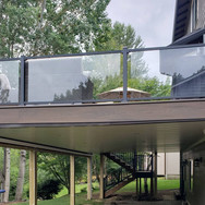covered patio, lighting, glass railing, trex deck