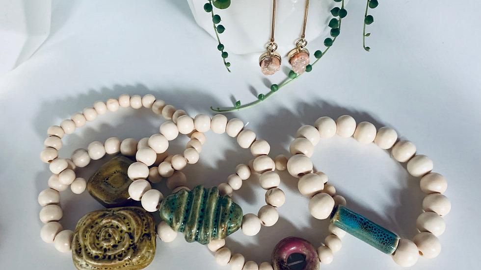 hand cut ceramic + wood bead bracelets