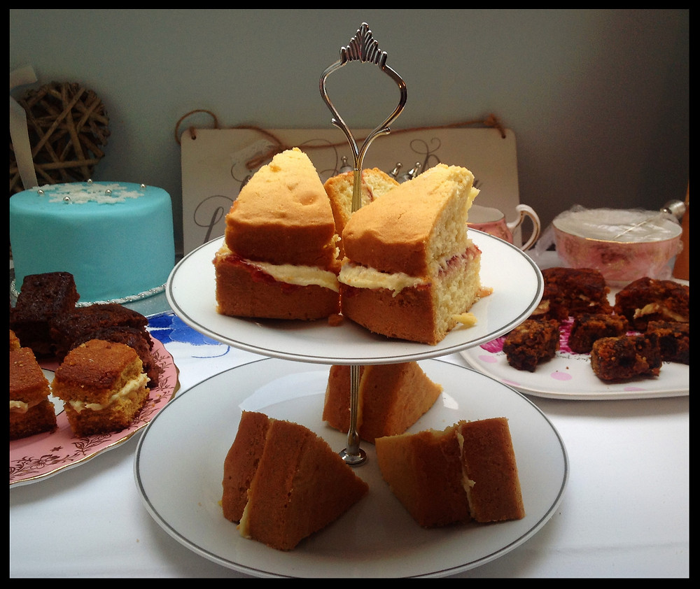 Samples of different cakes on vintage crockery prepared for a wedding cake tasting