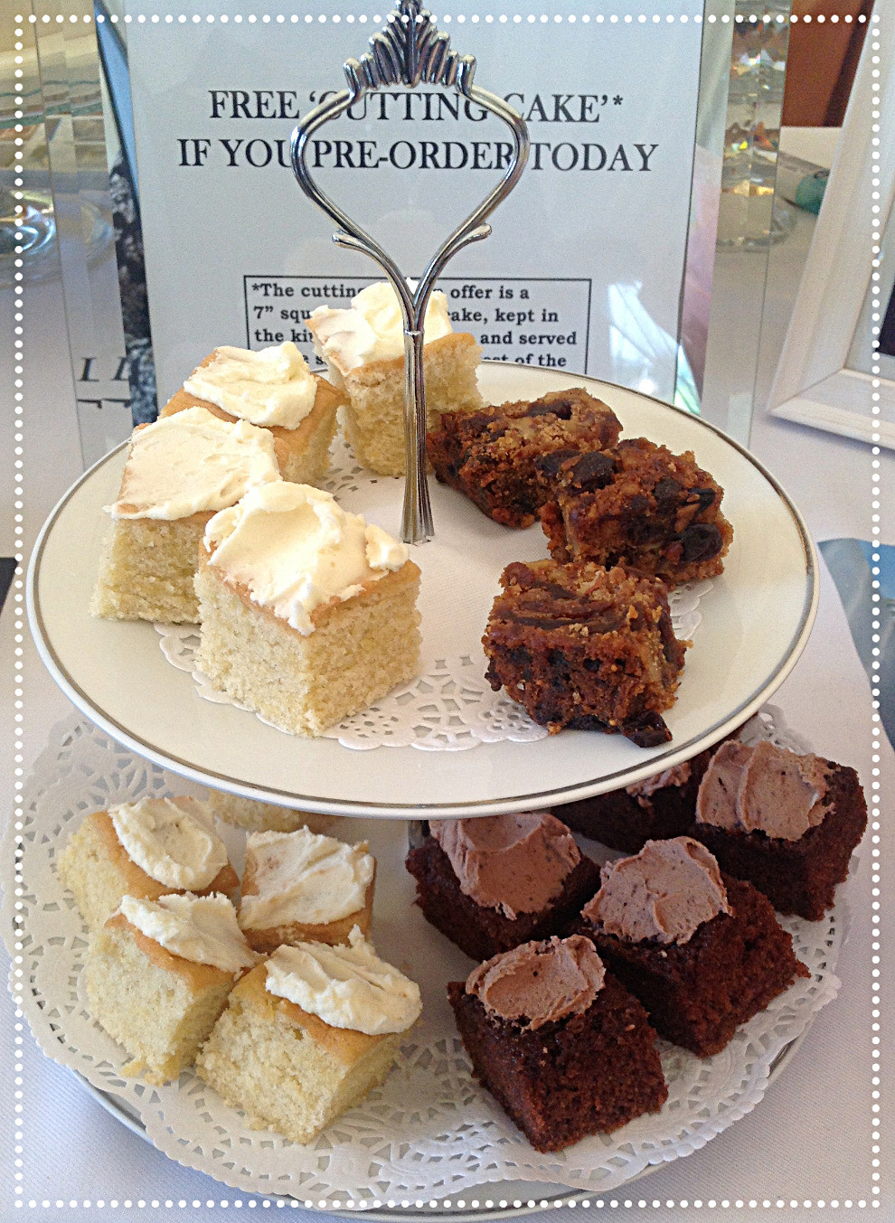 Samples of different cake flavours on a vintage cake stand at a wedding fair