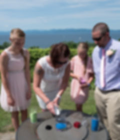 Mom pouring sand during wedding