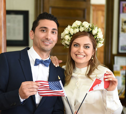 Couple holding flags from their country