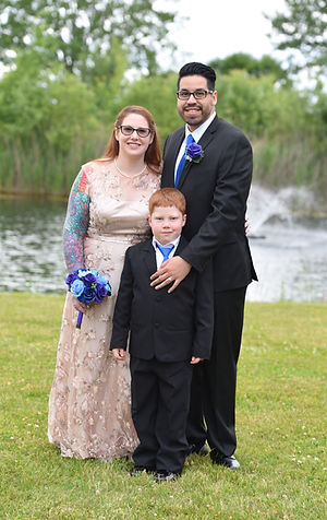 Red haired bride groom and their son