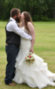 Bride and groom kissing in North Hero