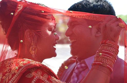 Napali wedding couple laughing