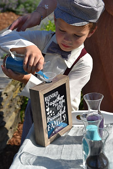 Boy Pour Sand during wedding