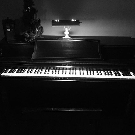 My childhood piano...a 1972 Wurlitzer spinet.  I love this piano so much.