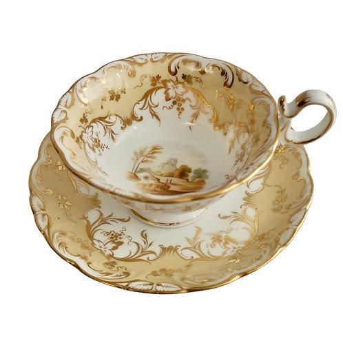 Coalport teacup, beige with landscapes, Adelaide shape, ca 1840 (1)