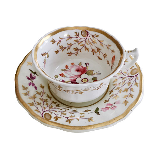 Staffordshire teacup, white with hand painted flowers, ca 1825