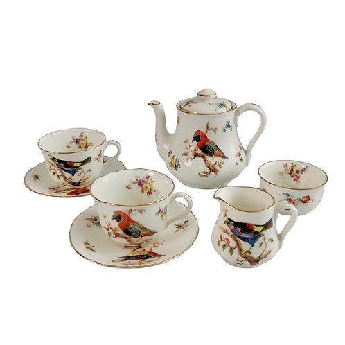 Royal Doulton children's tea set, white with red birds, ca 1923