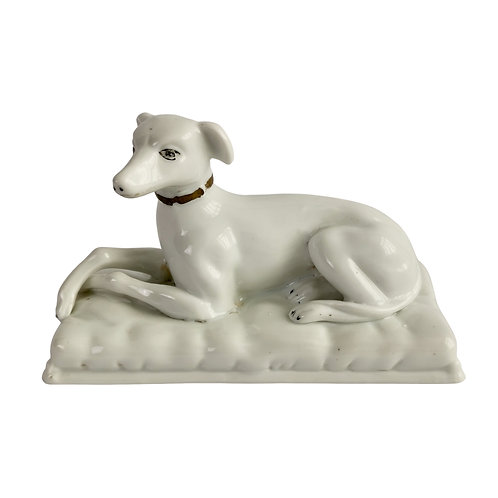 Staffordshire porcelain figure of a white whippet , early 19th C