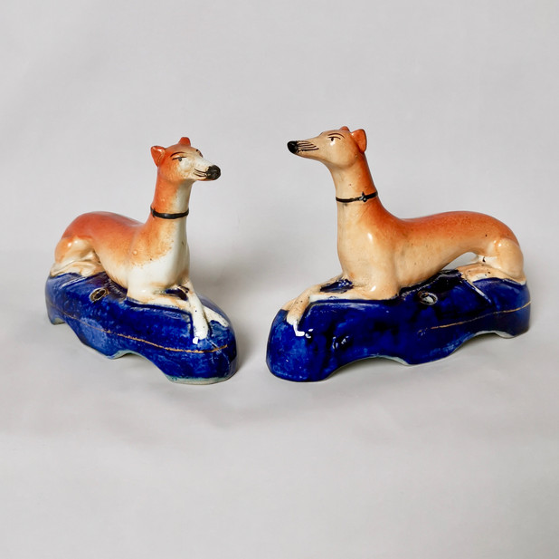 Pair of greyhound/whippet pen holders, early 19thC