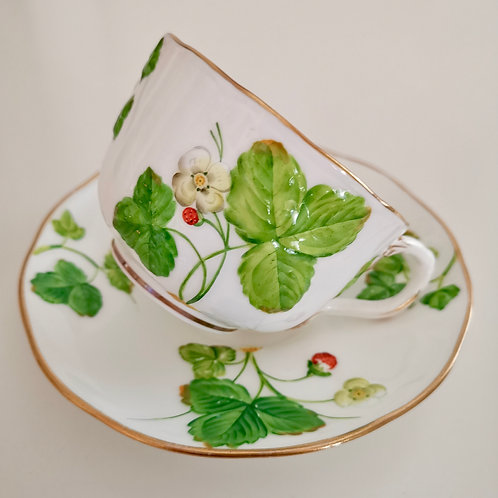 Minton teacup and saucer, moulded strawberries, 1855