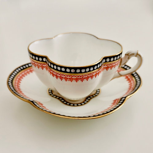 Coalport teacup and saucer, quatrefoil black and red, 1875-1881