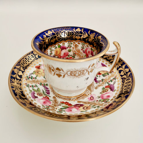 Coalport coffee cup, rich gilt and hand painted flowers, ca 1825