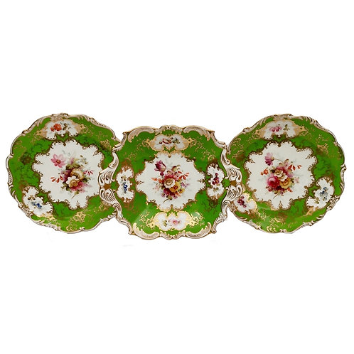Set of Coalport plates, apple green with flowers by F. Howard, 1900-1920