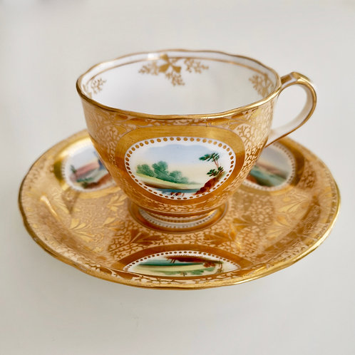 Sir James Duke teacup and saucer, gilt with landscapes, 1860-1863