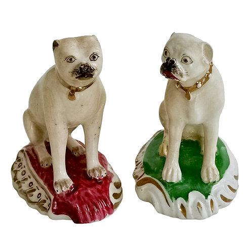 Two Rockingham pug dogs on Rococo base, ca 1835