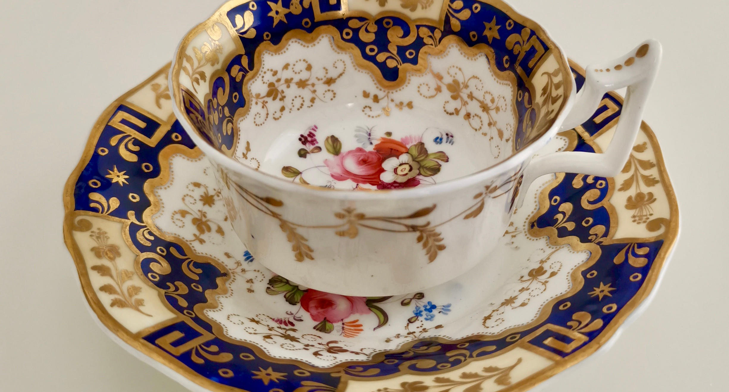 New Hall teacup with Chinese keys and flowers