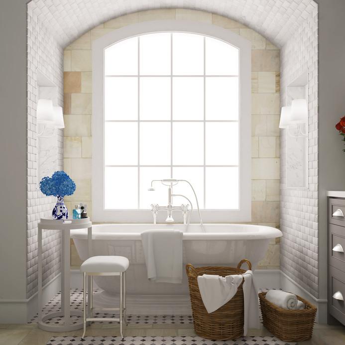 Badezimmer mit Badewanne ausgelegt mit weißen Wandfliesen und weiß/schwarzen Bodenfliesen