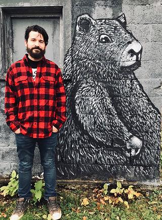 Brad Leiby infornt of Gopher Mural
