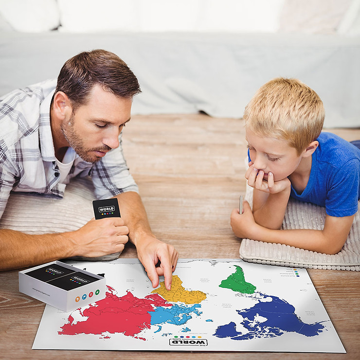 Father and son playing the world geography board game