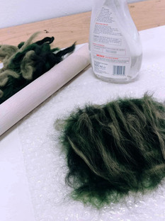 what you need for wet felting: merino wool tops, bubble wrap, warm soapy water, a rolling pin and towel.