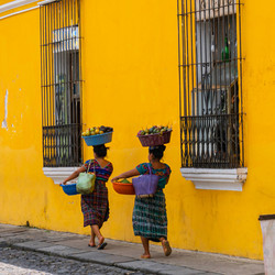Two women walking in Antigua