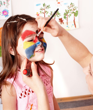 Child preschooler with face painting. Ma